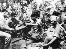 Filipino Soldiers being taught by US Marines on how to operate the .30 Cal. MachineGun.
