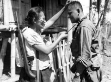 Captain Nieves Fernandez, with a brand new .30 cal. M1 Carbine and a sharp bolo, shows US Army Pvt. Andrew Lupiba how she used her long knife to silently kill Japanese soldiers during the Japanese occupation of Leyte Island. Image taken by Stanley Troutman on 7 November 1944, at Mabuhay Las Piñas, Leyte Island, Philippines.